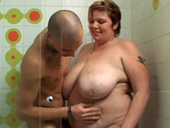 Fat woman with big tits sucking and riding in the shower